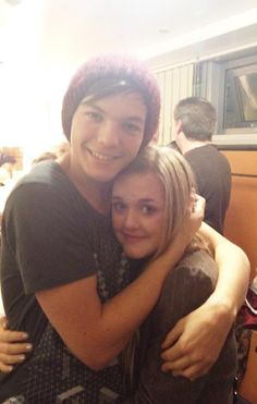 Louis and Lottie  i just love how he hugs his sisters just look at him he is literally cuddling her