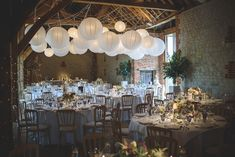 Rustic Barn Reception with hanging paper lanterns | Sassi Halford Lace Long Sleeve Bridal Gown | Classic Rustic Barn Reception | Lilac, White & Grey Colour Scheme | Hanging Paper Lanterns Decor | Image by Guy Collier Photography | http://www.rockmywedding.co.uk/sophie-sean/