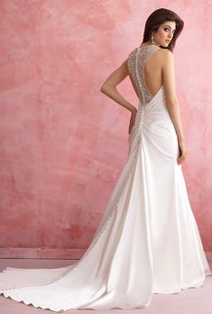 Brides: Allure Romance. A unique racerback is the richly beaded star of this sculpted satin gown.