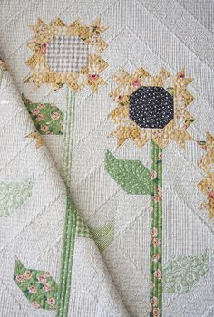 Scrappy Sunflowers quilt pattern by Lella Boutique. Fabric is Olive's Flower Market/Sugar Pie/Farmer's Daughter for Moda fabrics.