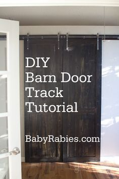 DIY Barn Door on a Track. Comes with plans! It turned out adorable. Check it out! Tutorial here: http://www.babyrabies.com/2012/09/diy-barn-door-track-tutorail/