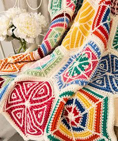 Every hexagon in this mesmerizing throw is unique and interesting to crochet. A total of 19 hexagons using 12 light-hearted colors are a visual treat wherever this throw is displayed.