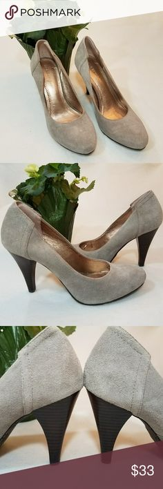 "Gray Suede BCBGeneration Pumps sz 6.5B These beautiful, classic BCBGeneration gray pumps are a closet essential that can easily go from day to night with comfort! They feature suede upper, slip-on styling, lightly padded insole, almond toe, stitching detail around counter (back of shoe), a 3.75"" wood stacked heel, and a rubber sole to prevent slipping. There is a mark on the right toe vamp which was there when I bought them and there is slight tearing to the metallic lining on the left shoe…"