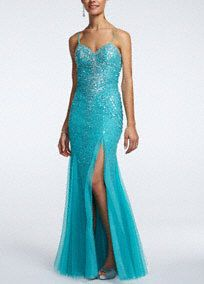 Lights, camara, action! You will look red carpet ready in this exqusiste beaded prom dress!  Fitted bodice with spaghetti straps features dazzling all over beaded detail that is sure to catch the light all night long.  Floor length mesh with side split finishes off the look.  Fully lined. Back zip. Imported polyester.  Dry clean only. Do not use Perchlorethylene Solvent. Do not spray Alcohol based products such as perfume or hairspray directly on garment.