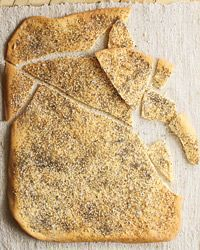 Lavash can be a soft flatbread, but Jessamyn Waldman developed this recipe based on Armenian-style lavash, which is very crisp and dusted with seeds or spices.