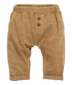Check this out! BABY EXCLUSIVE. Pants in slub cotton jersey with an elasticized waistband, mock fly with buttons, side pockets, and one back pocket. - Visit hm.com to see more.
