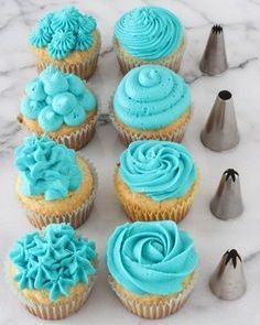 Video: Cupcake Decorating Tips - aqua cupcakes. I don't even like cupcakes, but if you put aqua frosting on them I might be tempted. Today's post isn't a recipe, instead it's a quick video and tutorial about how to decorate cupcakes using piping tip Cupcake Decorating Tips, Cookie Decorating, Decorating Ideas, Wilton Cake Decorating, Deco Cupcake, Cupcake Cakes, Wilton Cupcakes, Fondant Cakes, Food Cakes