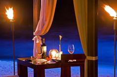 Enjoy your own private candlelight dinner on the beach at The House!
