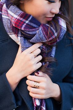 Snuggly plaid scarf with striped dress underneath and classic wool coat.