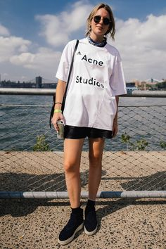 17 Ways To Take Your Gym Clothes To The Streets #refinery29  http://www.refinery29.com/adidas-fanatic-new-york-athleisure-street-style#slide-25  It's easy to look good when you work for one of the hottest brands in town. Acne's Stephanie Suits shows off her team pride with an oversized jersey-style top and leather shorts....