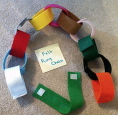 "Busy Bag 2: Felt Chain     Cut strips of felt. Mine are 1.5 inches wide by 9 inches long. Sew small pieces of velcro to the ends of each strip on opposite sides. The children can use them to make roads, bracelets, necklaces, ""paper chain"" style links, etc."