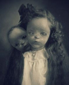 Creepy girl with two heads.