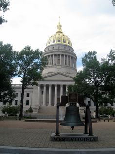 Charleston, WV. This dome is runner up to PA. It's gold and black and very stunning. The replica of the Liberty Bell in foreground is one of nine that were given to the various states.