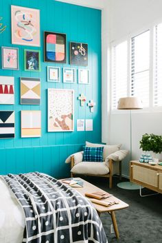 Love the cyan/teal wall colour, with the muted contrast, making it all the more effective.