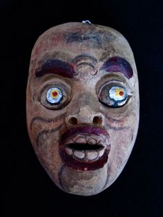 Carved Wood Mask with Bulging Eyes. SOLD