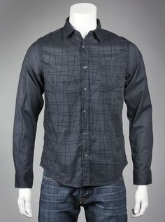 Desigual Mens Bruno Shirt in Negro Black goes with everything and that goes for mens clothing too. This chic, collared, long-sleeve button up is just what you need to polish your wardrobe. Roll the sleeves up for a more casual appearance or leave them down for a business casual look.