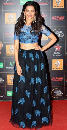 Deepika wore a Shehlaa lehenga. The lace top was lovely.