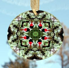 Grosbeak Geometric Kaleidoscope Mandala Glass Sun Catcher titled Bleeding Heart. <br /> <br />This stunning grosbeak beveled glass sun catcher illuminates my geometric mandala kaleidoscope design when light shines through it! It is 3 - ½ inches in diameter and has a beveled edge. The Suncatcher comes with a ribbon and suction cup for hanging. <br /> <br%...