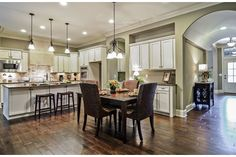 This open kitchen and dining area create an ideal space to entertain or relax with family. The Durbin plan built by Drees Homes at Arrington Retreat. Nolensville, TN.