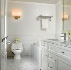 Small white bathroom designs stylish small white bathrooms design ideas with pictures white subway tile bathroom . Carrara Marble Bathroom, White Subway Tile Bathroom, Beveled Subway Tile, Wainscoting Bathroom, Bathroom Flooring, Subway Tiles, Marble Floor, Wainscoting Ideas, White Tiles