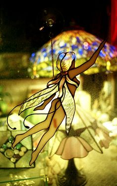 https://flic.kr/p/7XCmGB | Stained Glass Fairy | Very pretty piece and I like the lamp bokeh.