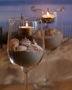 DIY Beach wine glass candle holders wedding favor/ table centerpieces all in one. one for each guest & possibly monogram the glass with a simple DIY project! Wine Glass Candle Holder, Votive Holder, Glass Votive, Mini Terrarium, Do It Yourself Wedding, Ideas Geniales, Seashell Crafts, Crafts With Seashells, Seashell Art
