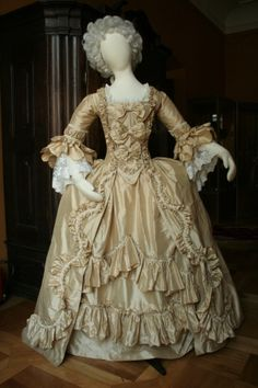 rococo everyday dress of high class lady around 1760. Garment is made of silk, trimmed with silk decoration tape. It is every day dress of high class woman.