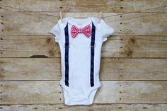 This adorable onesie is perfect for your little ladies man. The onesie comes with 2 different bowties that attach with snaps so you can mix and match to create the perfect look each day. The suspenders are sewn down keeping the buckle safe and secure. I use Carters onesies, the sizing is as follows.  Newborn: Up to 21.5 inches, 5 - 8 lbs 3 Month: 21.5 - 24 inches, 8 - 12.5 lbs 6 Month: 24 - 26.5 inches, 12.5 - 16.5 lbs 9 Month: 26.5 - 28.5 inches, 16.5 - 20.5 lbs 12 Month: 28.5 - 30.5…