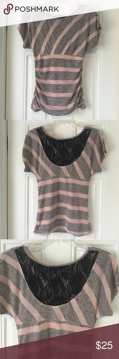 Beautiful Pink & Gray Top with Lace Back This beautiful top with lace back is perfect for any kind of day! It comes in a size medium and the top part of the back is lace. The top is made up of rayon and polyester and some spandex since this top is form fitting, and the inside lining is 100% polyester. Let me know if you're interested! BCX Tops Blouses