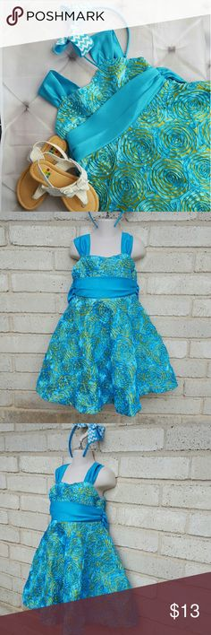 """Turquoise Blue 3D Floral Print Easter Dress Sz 4t Rare editions brand bright turquoise blue floral 3d fabric on a lime green backing sleeveless dress. Tie bow sash in back and zipper closure. Comes with matching headband.  Excellent condition. Shoes are sold seperately (size 10 toddler).Dress is tagged a 4t. Measurements :  length 24""""  10""""across front waist laying flat   #ravenkittyminis #easterdress #turquoise #lime #set #matching #3d #pageant #natural #formal #holiday #egghunt #size4t Rare…"""