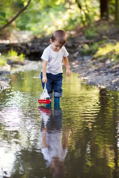 Image result for little boy with toy boat in stream photos