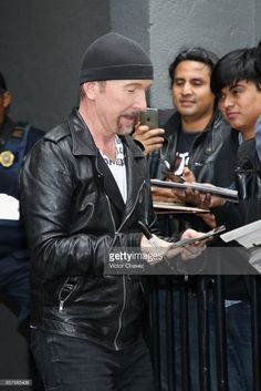 The Edge of U2 signs autographs on October 04, 2017 in Mexico City, Mexico.