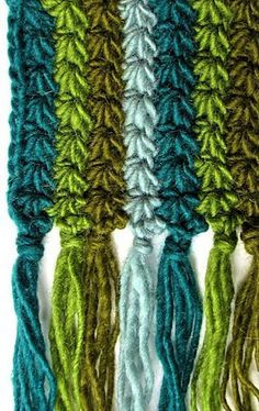 Starpath Scarf is a stripy new crochet pattern that includes a star stitch how-to. This version is one strand of worsted weight wool yarn with tasseled fringe.