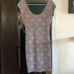 NWT Tan lace cap sleeve bodycon dress New with tags tan lace cap sleeved dress- Size large on tag, but better for a true medium- some stretch Dresses Mini