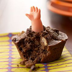 chocolate cupcake (oreo crumb for dirt?) with doll arm