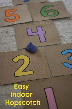 Easy indoor cardboard hopscotch - here's a fun rainy day activity! Great way for the kids to burn off some energy when they're stuck indoors. Turn a few sheets of cardboard into a hopscotch that they can play with inside! Indoor Activities For Toddlers, Gross Motor Activities, Rainy Day Activities, Learning Activities, Games For Kids, Kids Learning, Rainy Day Fun, Rainy Days, Indoor Play