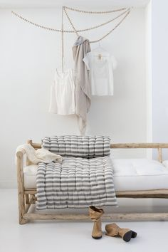 Love the daybed...the clothes clutter: not so much
