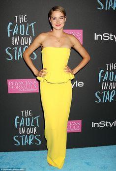 Go bold: Even after putting on heels, her floor length frock kept her strappy heels hidden...