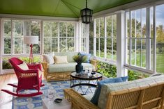 Sunroom / glassed in porch  Houzz Tour: Sunny Colors Lighten a Century-Old Home  Brightness and elegance without a trace of stuffiness bring the individuality of a seaside Rhode Island home into the light.  traditional porch by Andrew Suvalsky Designs