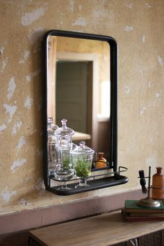 DETAILS This Metal Frame Pharmacy Mirror Has A Convenient Shelf For Displaying All Of Your Vintage