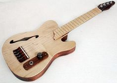 Vintage Telecaster Guitar Style Acoustic Electric Concert Ukulele - AMAZING. I would buy this in a heartbeat if I had the money!