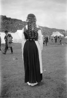 Icelandic woman in traditional costume with braided hair, at a Hotel at Thingvellir, Iceland - June 1930. (source) An international students' meeting is going on, in which the photographer Berit Wallenberg participates. Thingvellir was declared a National Park in 1930, and is today a UNESCO World Heritage