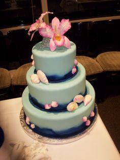 Beach theme wedding cake but more unique.