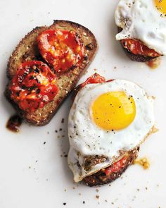 Charred Tomatoes with Fried Eggs on Garlic Toast | Martha Stewart Living - Make mom a healthy, hearty breakfast -- to serve in bed or at a beautifully laid breakfast table. With garlic and tomatoes, this delicious recipe is an upgrade to the classic eggs and toast combo that we're sure she will adore.