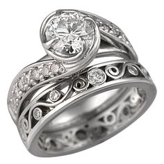 Rose Swirl Pave Engagement Ring features thorn-like prongs swirling around the center stone. Ideal cut accent diamonds are bead set in the band. 3mm wide.    - This Brilliant Rose Swirl Engagement Ring is paired with a Millegrained Curls Wedding Band.