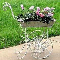 Your garden will look like a flower market in no time with this Flower Cart Plant Stand. It features delicate scrolling metal and a vintage brown finish. Flower Cart, Flower Pots, Container Plants, Container Gardening, Plants For Hanging Baskets, Garden Cart, Victorian Flowers, Flower Stands, Garden Planters