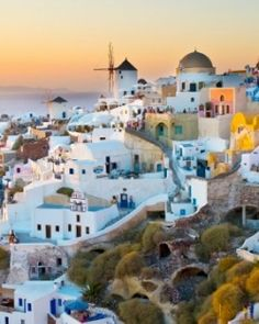 Katikies Hotel  ( Santorini, Greece )  Watching the sun set from the tip of Oia is one of Santorini's must do activities. #Jetsetter #JSVolcano