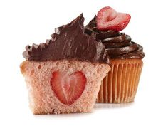 Valentine's Day idea: Strawberry stuffed cupcakes reveal a heart-shaped surprise in the center!