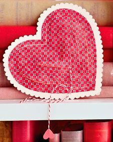 "Pull this heart-shaped valentine by its ""heartstrings"" to reveal a hidden message."