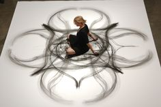 Artist and dancer, Heather Hansen. With a piece of charcoal in hand, she lets her imagination come to life.